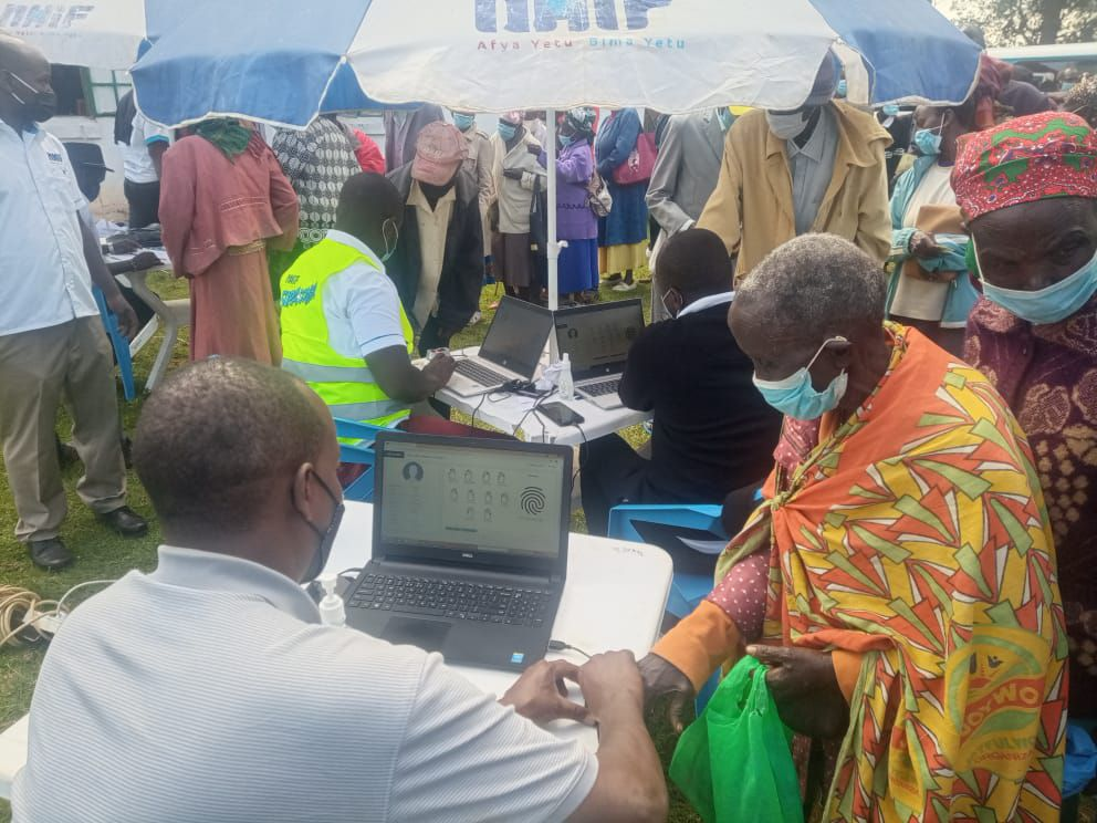 An-elderly-woman-from-Baringo-central-getting-registered-during-health-insurance-registration-exercise